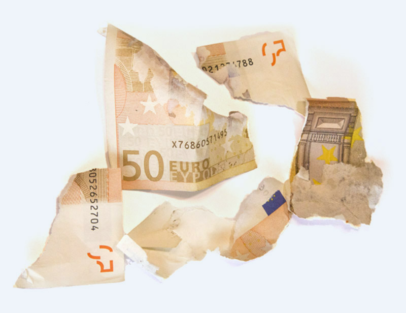 shreds of banknotes after a GlueFusion activation